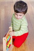 Boy playing with plastic blocks — Stock Photo