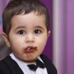 Baby eating chocolate — Stock Photo #46171237