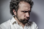Man with intense expression — Stockfoto