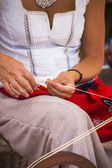 Woman spinning yarn — Stock Photo