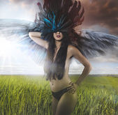 Naked woman with feathers — Stock Photo