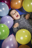 Boy playing with balloons — Stock Photo