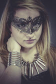 Gold, Beautiful blonde with silver jewelry and mask — Stock Photo