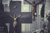 Jesus Christ on the cross in a cemetery — 图库照片