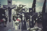 Jesus Christ on the cross in a cemetery — Foto Stock