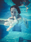 Water, teenager diving into a pool — Stock Photo