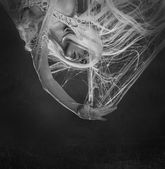 Woman caught in spider web — Stock Photo
