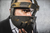 Dangerous business man with iron mask — Stockfoto