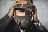 Dangerous business man with iron mask — Foto de Stock