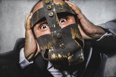 Dangerous business man with iron mask — Foto de Stock