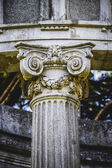 Corinthian capitals in a park — Stock Photo