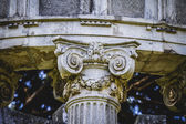 Corinthian capitals in a park — Stock Photo
