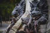 Bronze sculpture with demonic gargoyles — Stock Photo