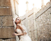Beautiful sexy woman posing in a castle — Stock Photo