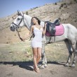 Sensual young beauty riding a horse — Stock Photo #14201400