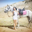 Stock Photo: Sensual young beauty riding a horse