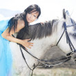 Sensual young beauty riding a horse — Stock Photo #14201466