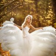 Female angel posing over an autumn sunset — Stock Photo