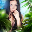 Beautiful girl in the jungle — Stock Photo #16825685