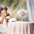Lovely little girl with flower crown on her head - Stock Photo