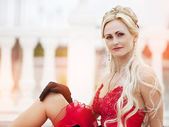 Attractive blond girl in red dress — Stock Photo