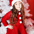 Cute girl and Christmas Tree - Stok fotoğraf
