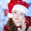 Cute girl and Christmas Tree — Stockfoto
