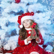 Cute girl and Christmas Tree — Stock Photo #16980911