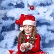 Little girl dressed as Santa Claus under the Christmas tree — Stock Photo #17160947