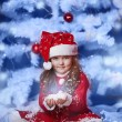 Little girl dressed as Santa Claus under the Christmas tree — Stock Photo #17160967