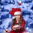 Little girl dressed as Santa Claus under the Christmas tree — Stock Photo #17160969