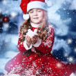 Little girl dressed as Santa Claus under the Christmas tree — Stock Photo #17161021