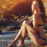 Beautiful girl on the beach — Stock Photo #18414707