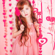 Beautiful young girl with heart — Stock Photo