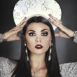 Glamorous girl in a headdress — Stock Photo