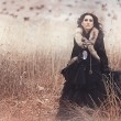Victorian lady.Young woman in black dress and corset - Stok fotoraf