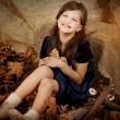 Stock Photo: Girl in autumn leaves