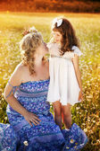 Mother with daughter on the meadow — Stock Photo