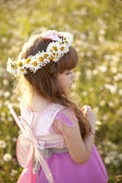 Cute child girl at camomile field — Stock Photo
