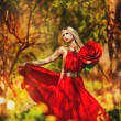 Beautiful blonde in a red dress - Stock Photo