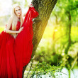 Beautiful blonde in a red dress — Stock Photo
