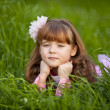 Beautiful little girl in a spring garden — Stock Photo