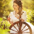 Stock Photo: Beautiful bride with old spinning wheel