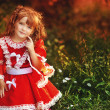 Litle girl in red fairy costume at the magic forest — Stock Photo
