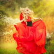 Angel lady in red dress posing in fairy summer park — Stock Photo