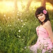 Stock Photo: Beautiful girl in pink dress at summer park