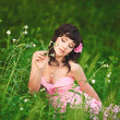 Beautiful girl in pink dress at summer park — Stock Photo