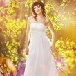 Beautiful bride in a golden park — Stock Photo