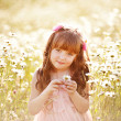 Little girl in a camomile field — Stock Photo