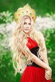 Beautiful girl in russian native style posing outdoors — Stock Photo